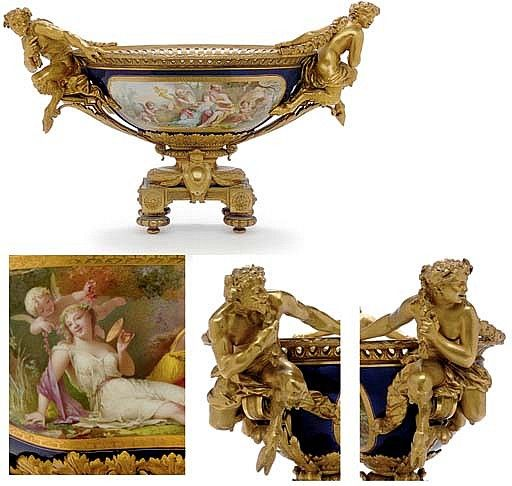 AN ORMOLU-MOUNTED SEVRES STYLE COBALT-BLUE GROUND OVAL CENTERPIECE LATE 19TH…