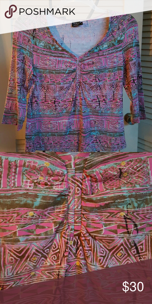 3/4 Sleeve Top Shades of pink, turquoise, brown and black make up the tribal looking print of this super cute 3/4 sleeve top. Versatile to be dressy with dress pants or skirt or casual with jeans. Choose the right accessories and you'll be rockin this shirt for certain! Tribal Tops Tees - Long Sleeve