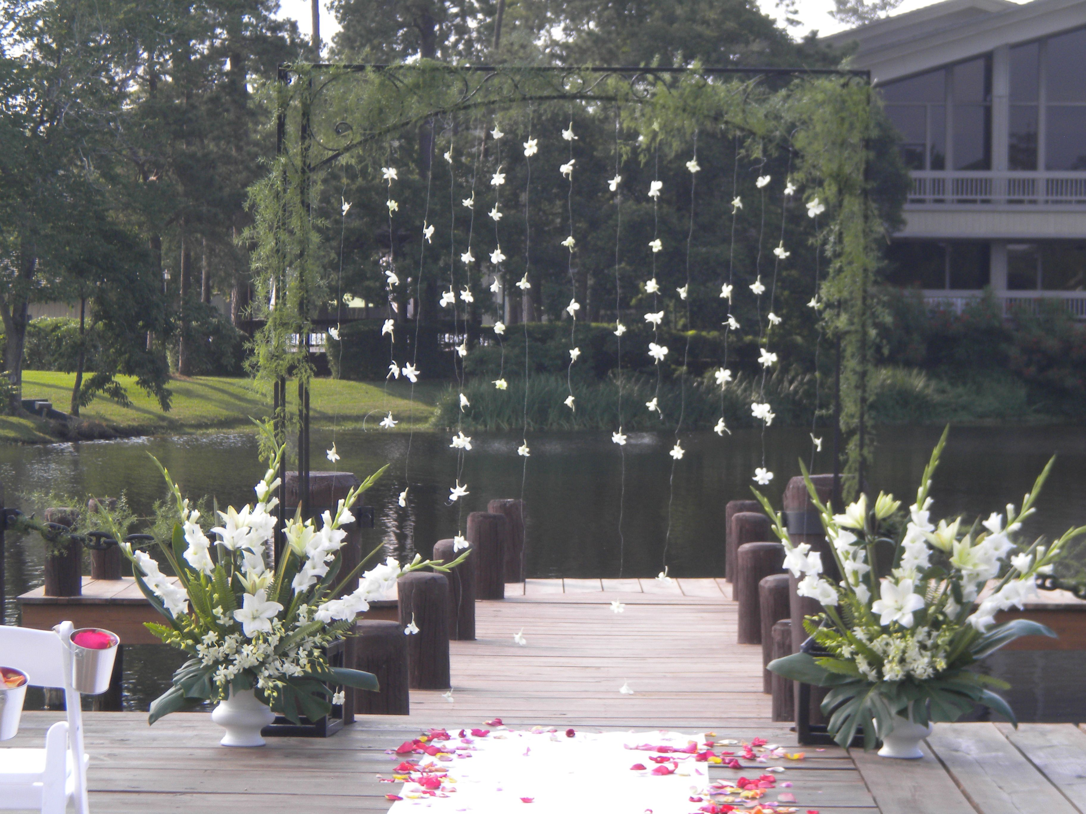 All white and gold wedding decor  Ceremony decor  arch with hanging orchids and all white free