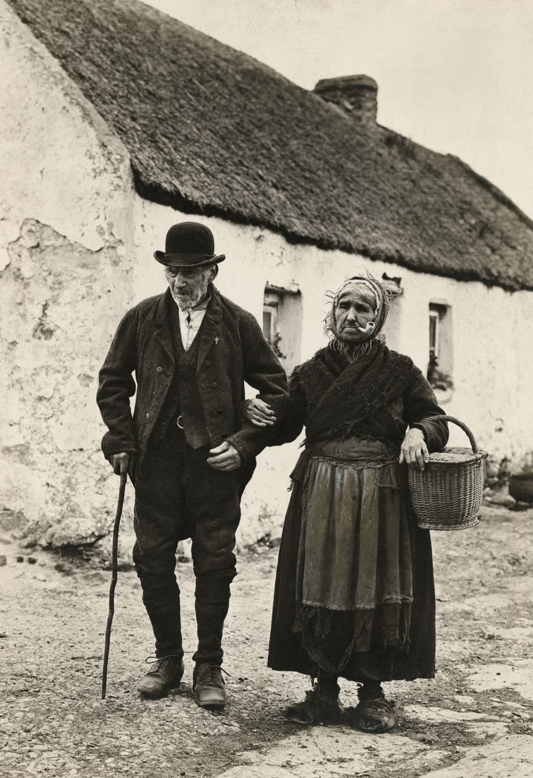 An elderly couple walk to the market in Galway, Ireland ...