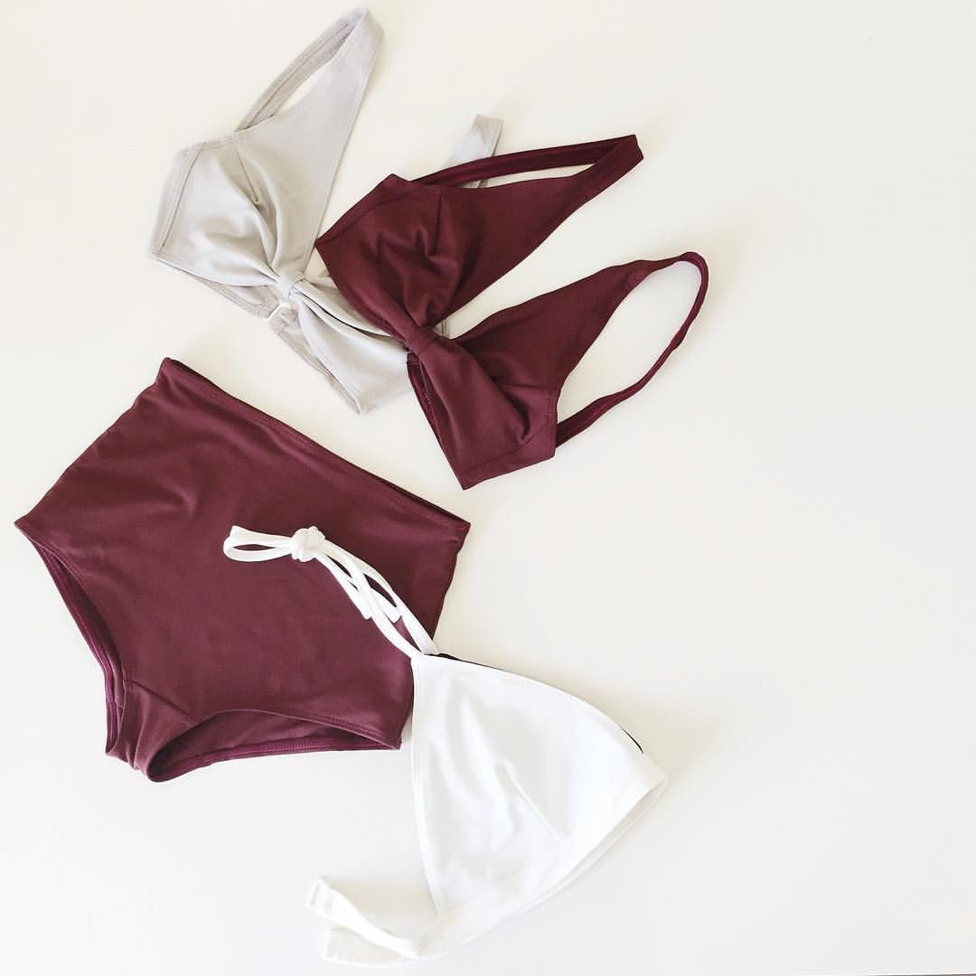In case you missed it, we're adding color to HDH Swim!  Pictured here, the knot top in new deep burgundy and light gray color and one of our white halter tops:)