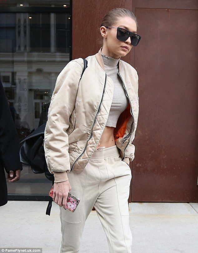 Sleek:The siren had her famous blonde locks pulled back and wore very large dark sunglasses