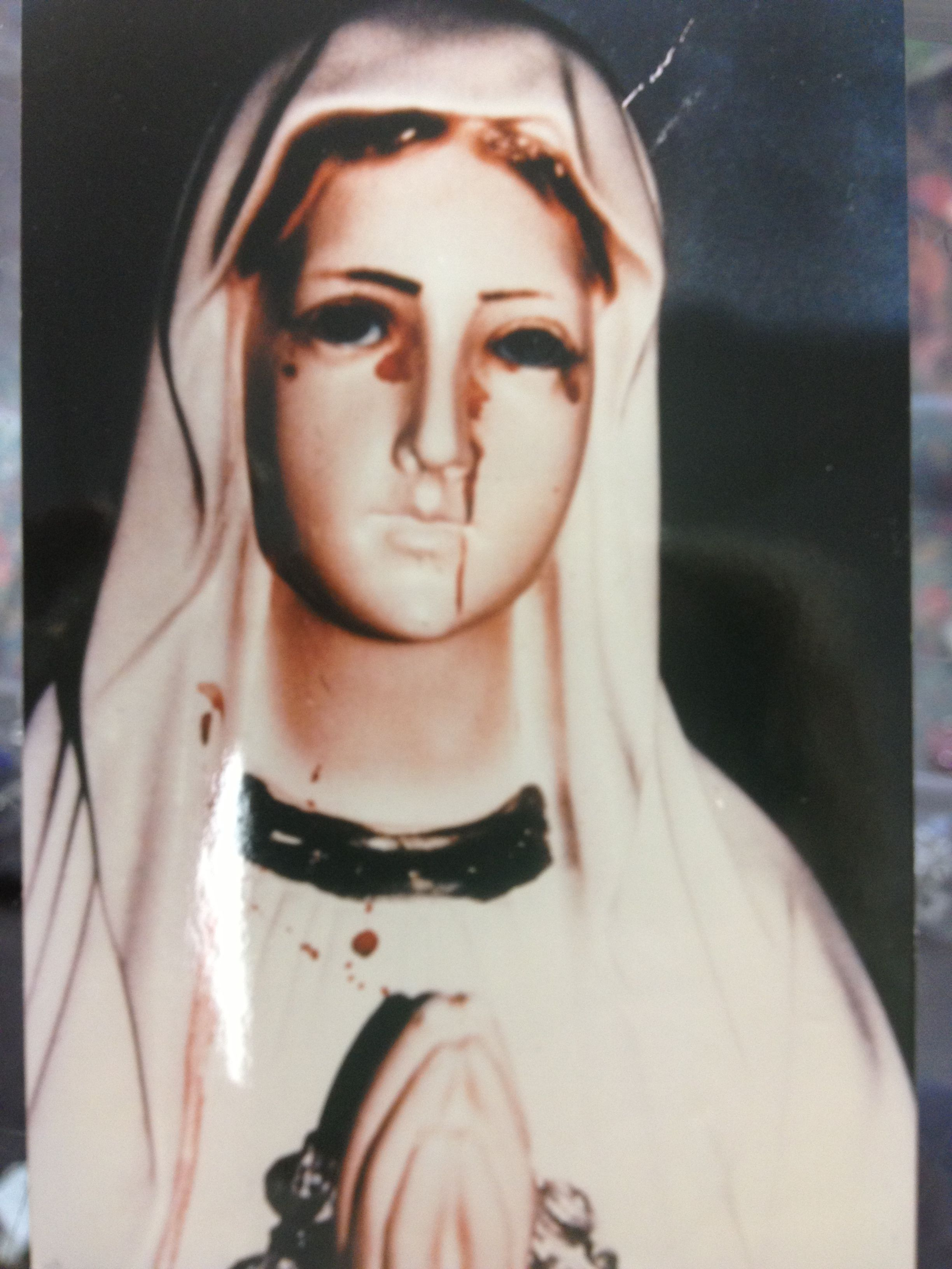 blessed mother statue crying tears of blood blessed
