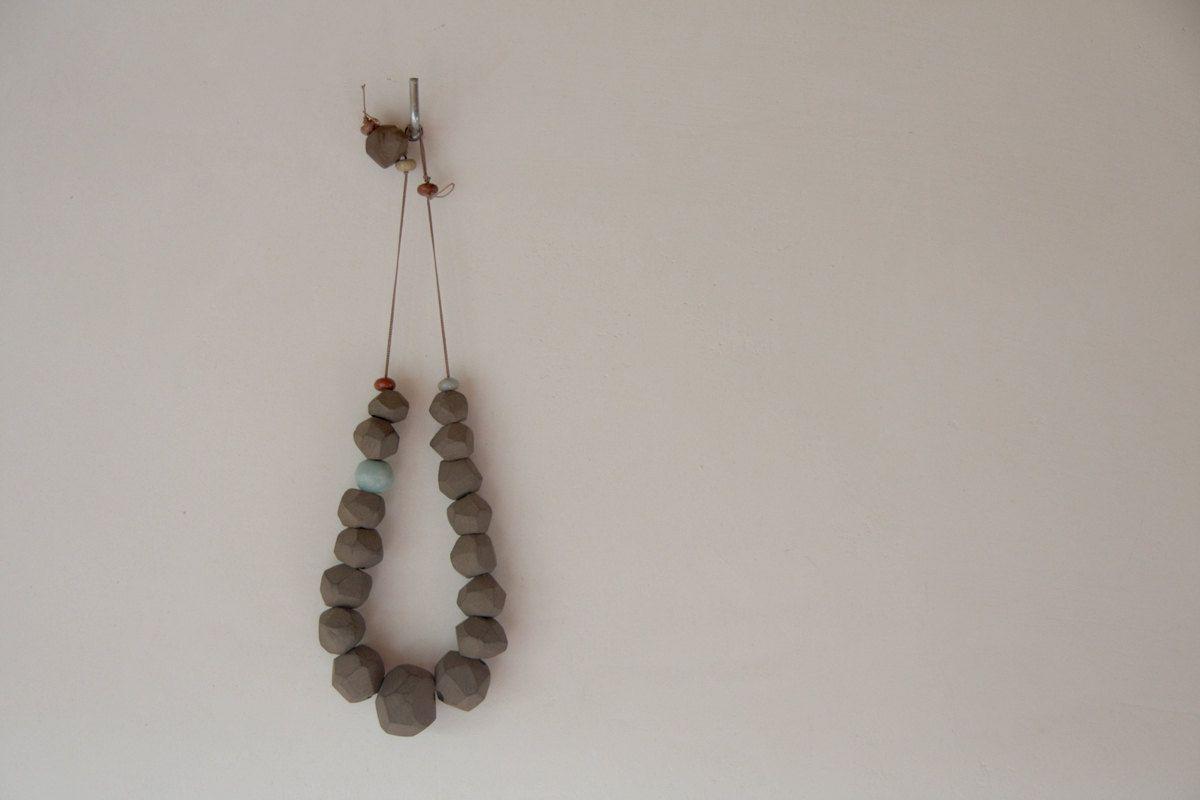 Faceted terracotta gemstone bohemian art necklace. $140.00, via Etsy.