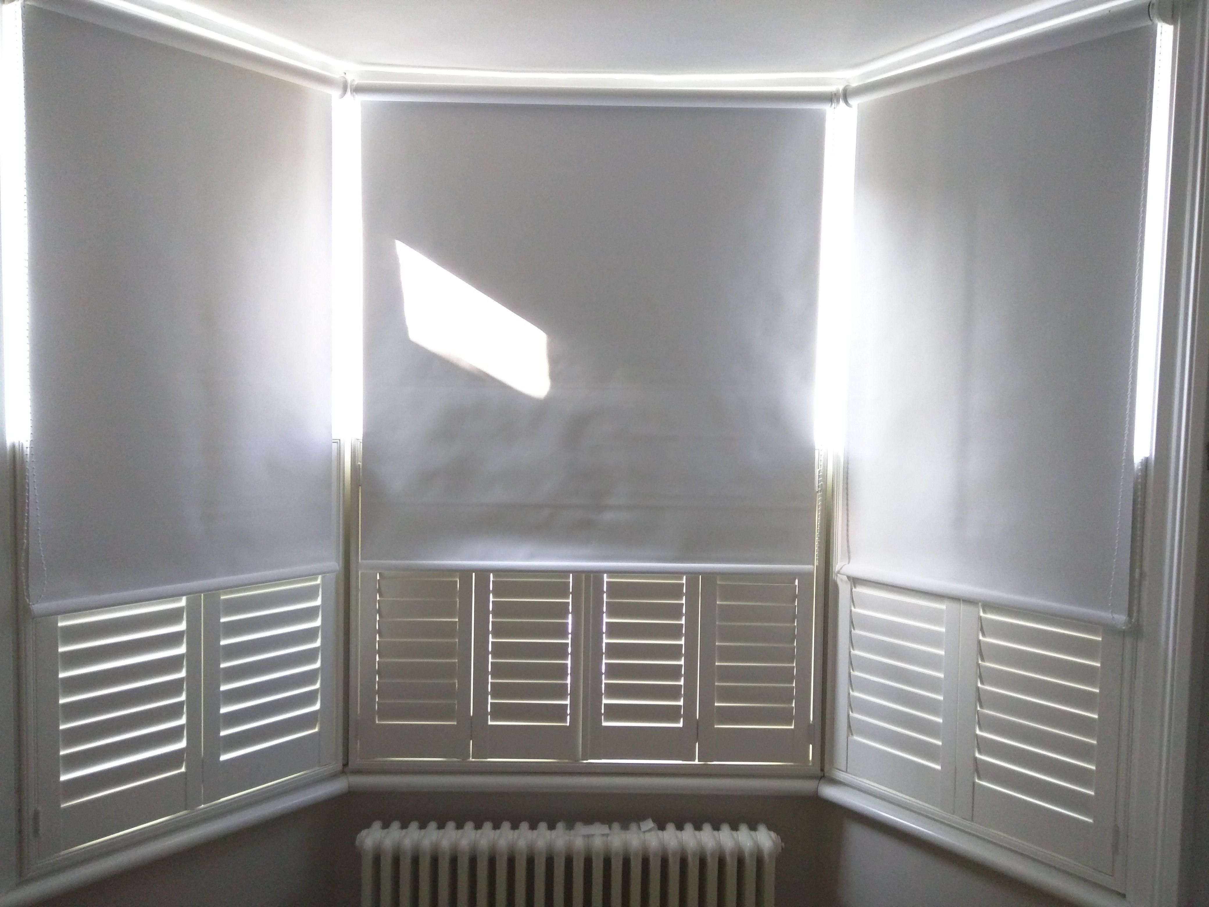 Blackout Roller Blinds With Cafe Half Height Shutters Bay Window Blinds Living Room Blinds Blindslogo Blindsandcu Wooden Blinds Blinds Blinds For Windows