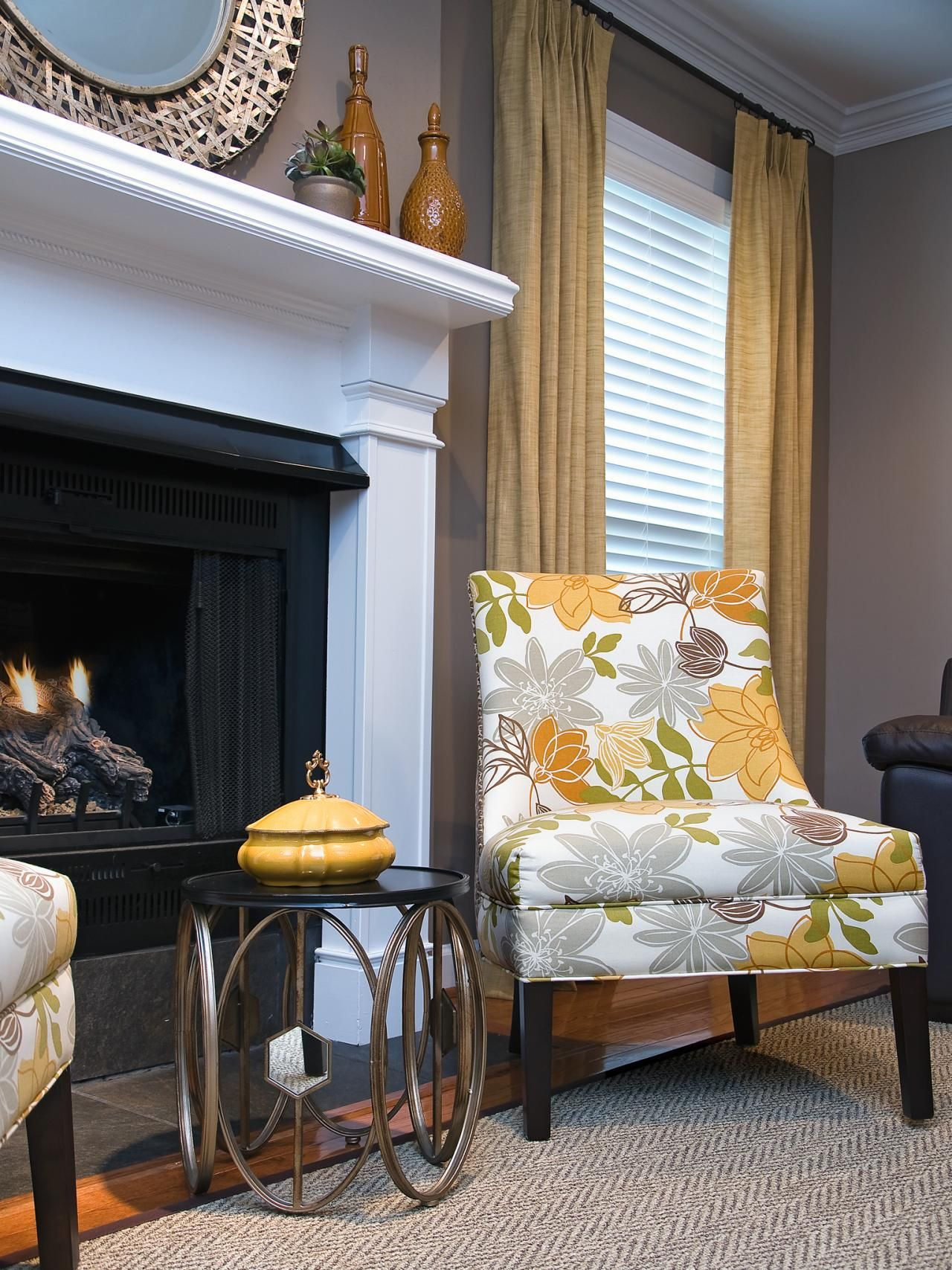 Armless Chairs Upholstered In A Modern Fl Fabric Offer Contemporary Aesthetic To This Sitting Area