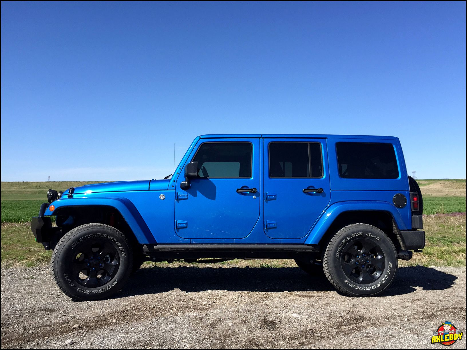 "Installed a 2"" Rancho Sport lift under this blue 2015 Jeep"