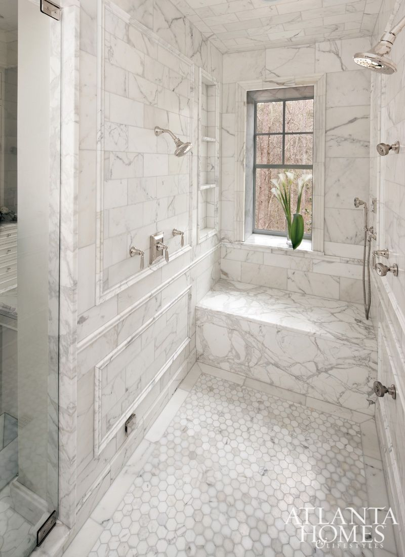 Marble Sit Down Shower With Silver Fixtures
