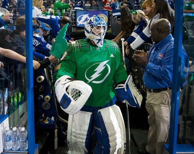 e3524ab66 TAMPA, FL - MARCH 17: Louis Domingue #70 of the Tampa Bay Lightning sports  a green warmup jersey for St. Patrick's Day during pregame warm ups against  the ...