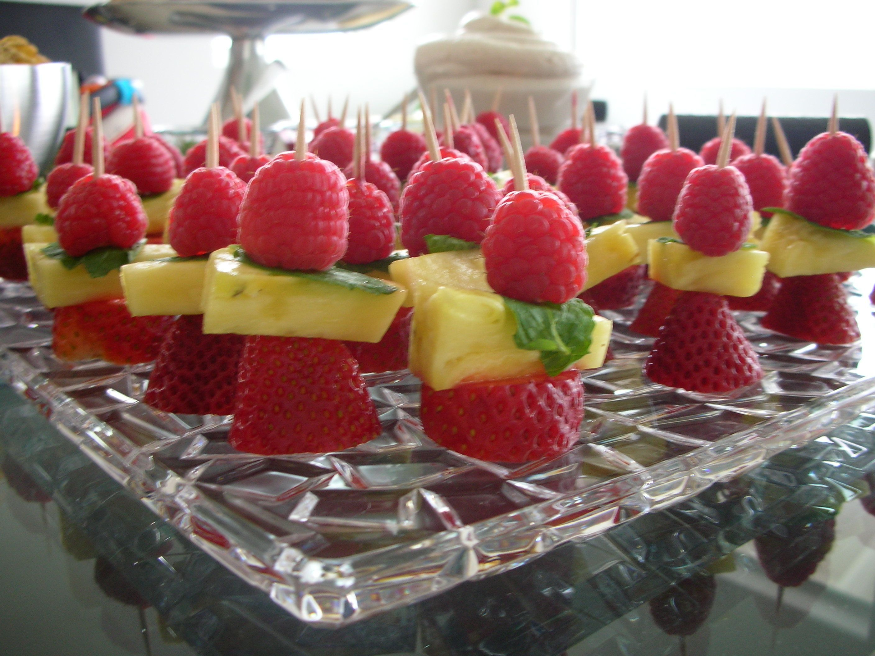Bite sized fruit kebabs raspberry mint pineapple and