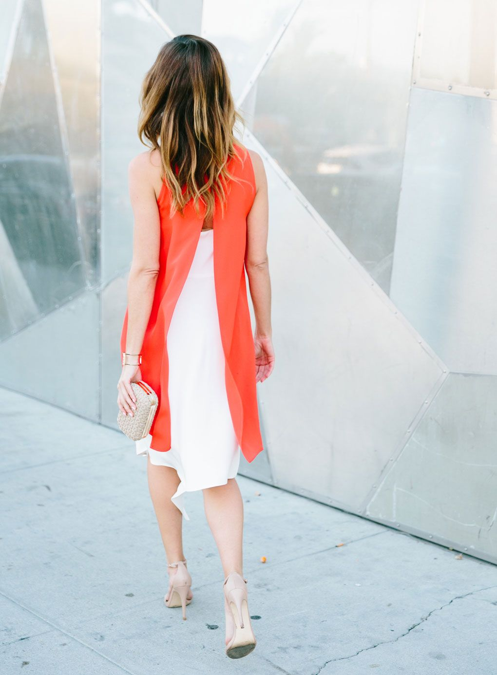 dc9fe540d63 Sydne Style wears an orange and white Hunter Bell dress for spring color  trends