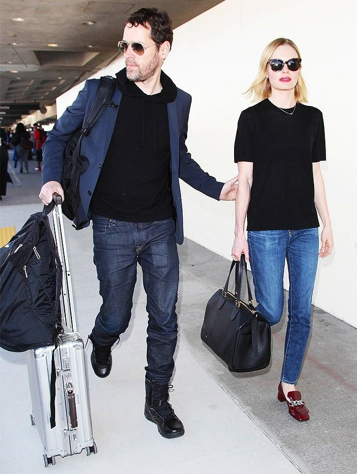 Kate Bosworth Wears A Black Top Blue Jeans Burgundy Prada Loafers And Duffle Bag