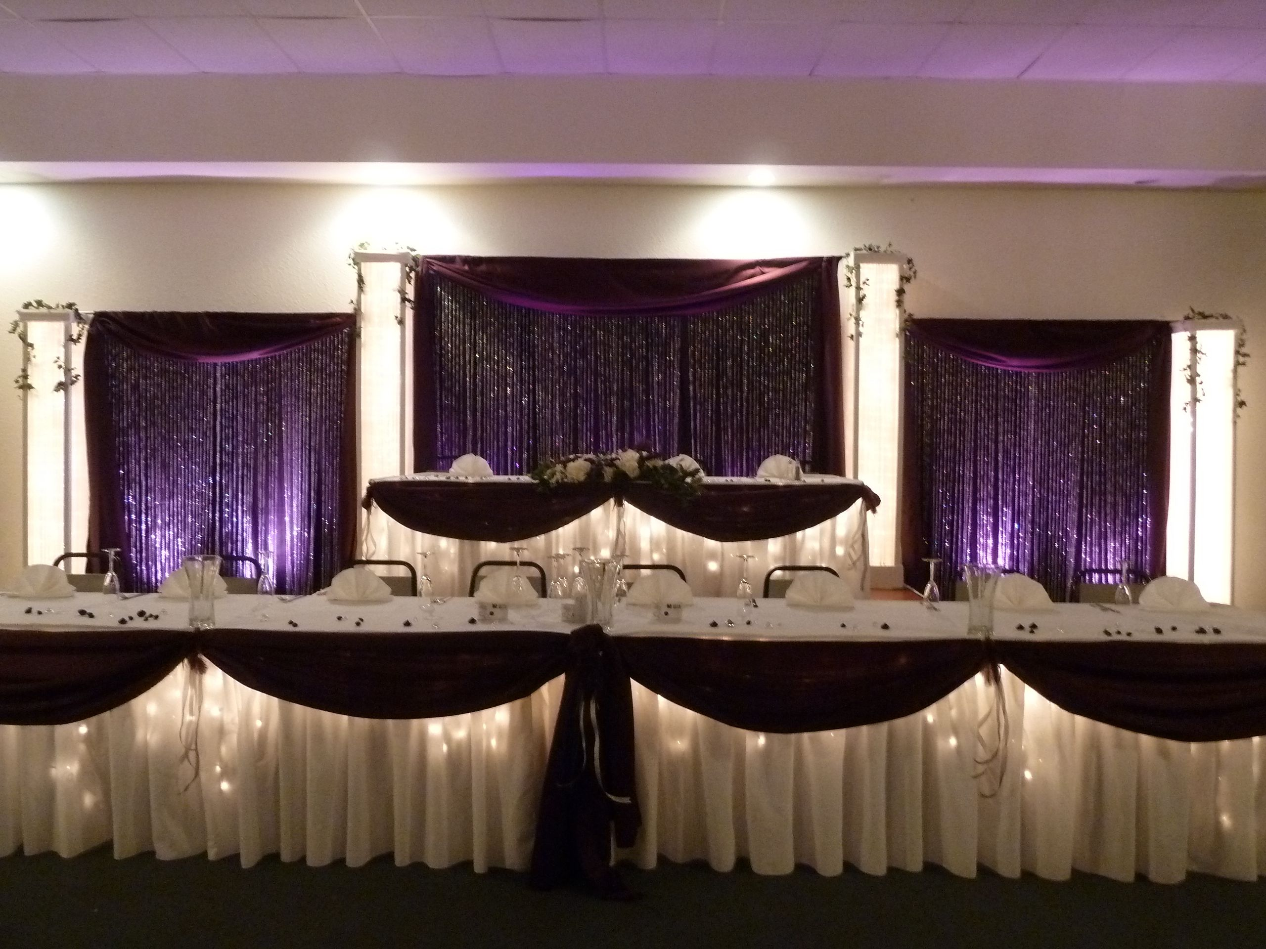 Head Table Backdrop With Crystals And Purple Uplights