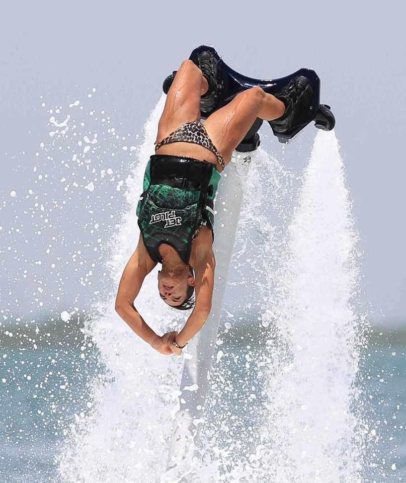 Flygirl backflips on a flyboard