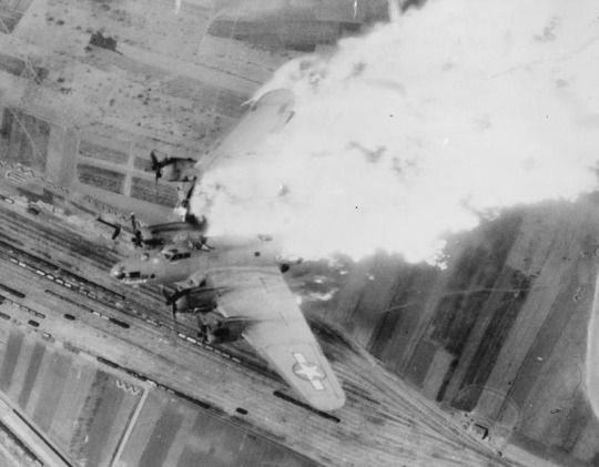 A B-17 of the US Fifteenth Air Force breaks up in flames after being hit by flak over a railyard at Nis, Yugoslavia,15th April 1944.