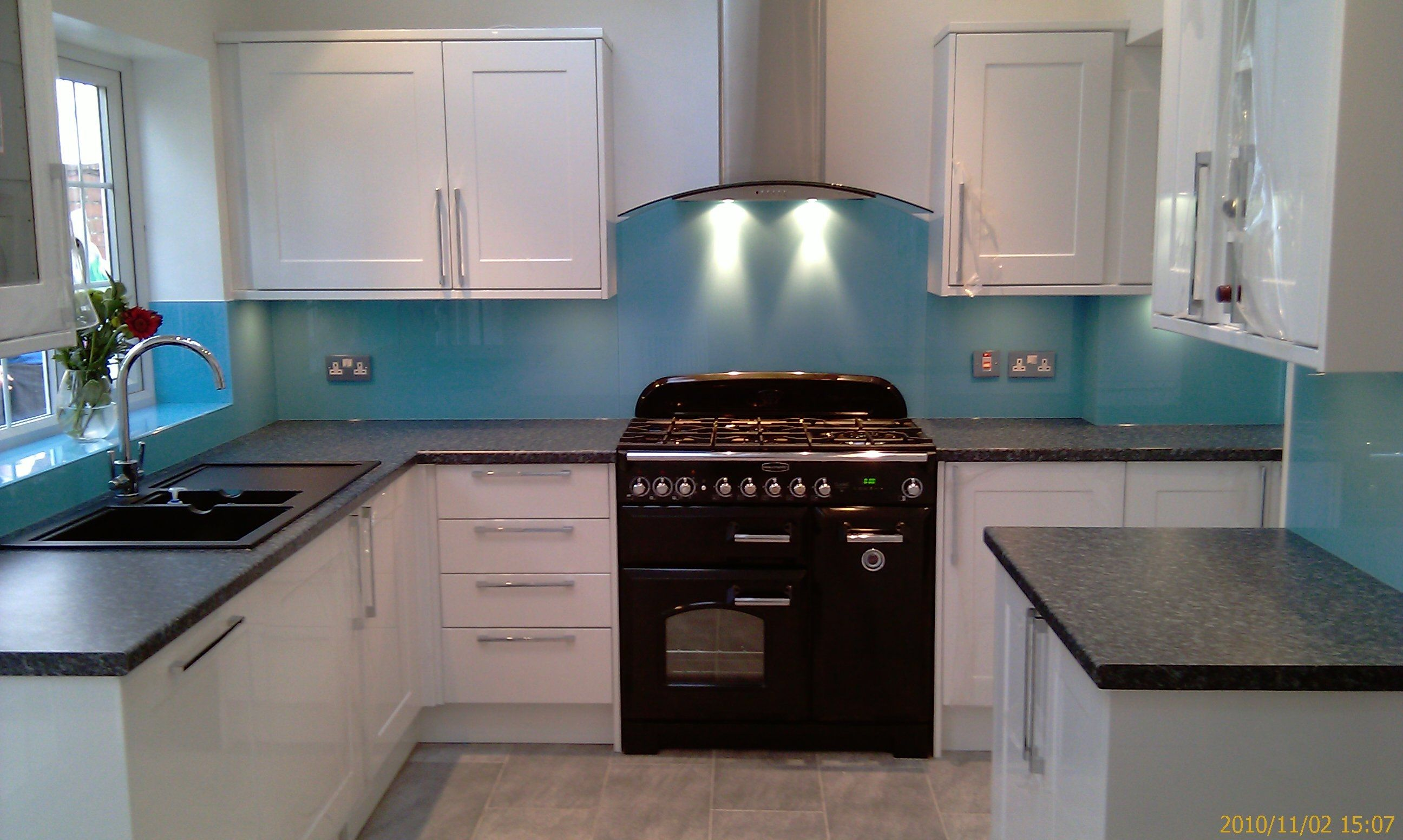 Splash Blue Coloured Glass Splashback In A White Kitchen With Curved Extractor Visit Easyglasssplashbacks