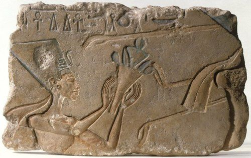 Limestone relief showing Nefertiti  Amarna  New Kingdom, c.1352-1336 BC  The image shows Queen Nefertiti wearing the famous tall, flat topped crown she wears in the famous bust currently in the Berlin Museum. She is making an offering to the Aten along with her husband Akhenaten (the figure in front of her).