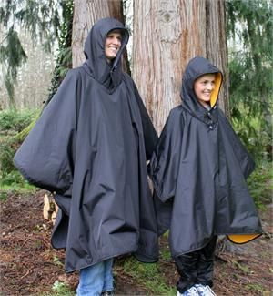 Waterproof ponchos for the girls in the bike
