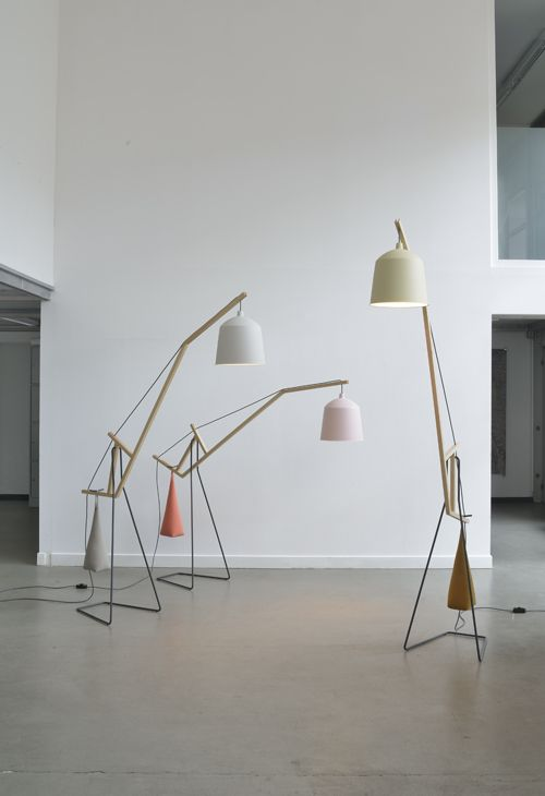 aust & amelung: a floor lamp  'a floor lamp' is based on the simple mechanism of a beam balance. A long beam cranes across the room and balances a lampshade on one side against a sandbag on the other. The sandbag can be moved manually into four positions weighing in different lighting situations.