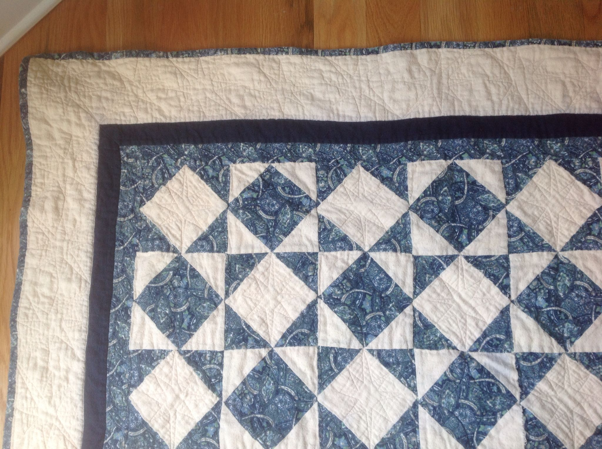 Close-up of blue and white flannel disappearing star quilt. Designed by my baby sister for her high-school graduation gift.