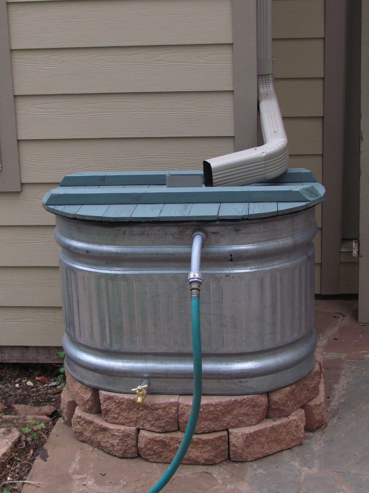 Stock tank rain barrel might be a project for this summer