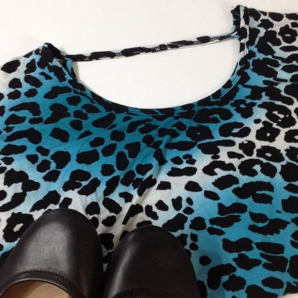 Leopard print top Short sleeve leopard print top. Sexy open scoop back! American Dream Tops