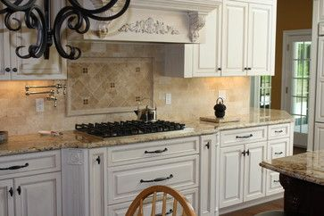 The backsplash is honed durango travertine 3x6 tile and glass stone mosaic inserts for the Kitchen design newtown ct