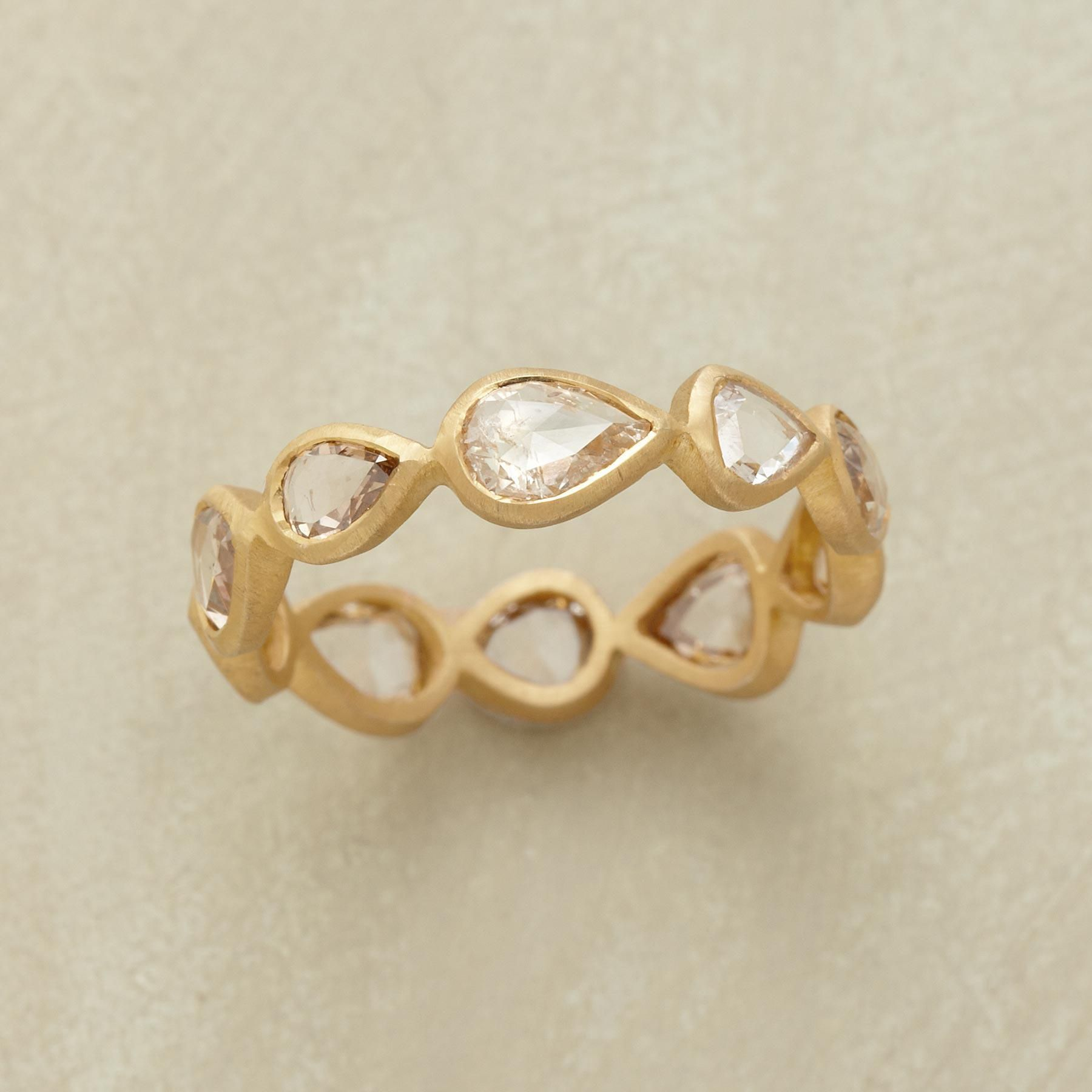 DIAMOND DROPLETS RING--Teardrop diamonds, each unique, line up luxuriously around the finger. They're framed in matte 14kt gold. Sundance exclusive in whole sizes 5 to 9.