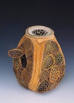 "Jan Hopkins -Transformation Vessel  – ""Protégé (womb vessel)- 9""x11""x12"""", 1998, Materials:  outer vessel:  agave leaves, lotus pod tops, Michigan sweet grass, Alaskan yellow cedar bark and nylon thread.  Inner sculpture: magnolia skeleton leaves, paper, bull kelp and waxed linen"