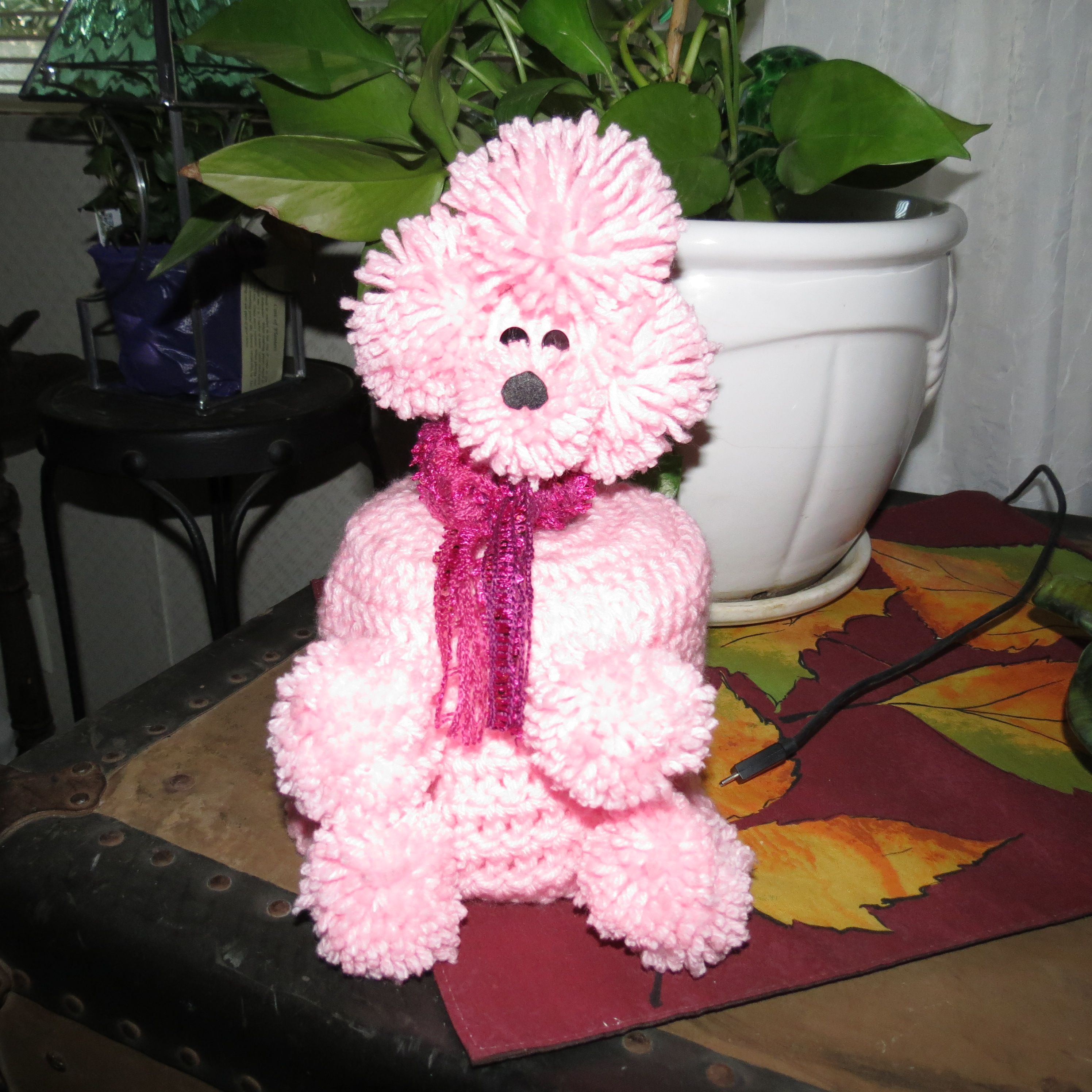 Poodle toilet tissue cover.
