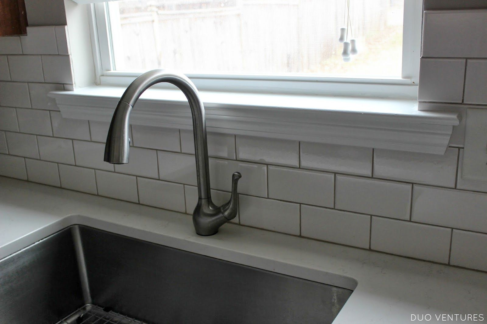 Subway tile at window with wooden sill and skirt via http ...
