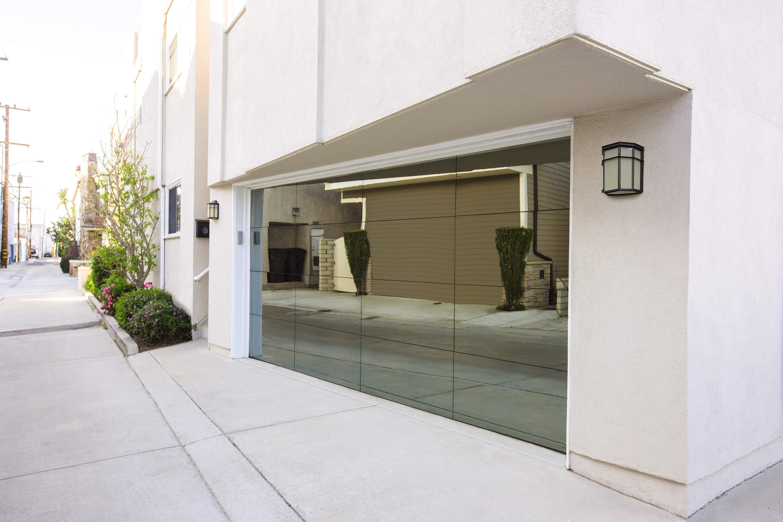 Frameless Look Garage Door Glass Garage Door Garage Doors Modern Garage Doors