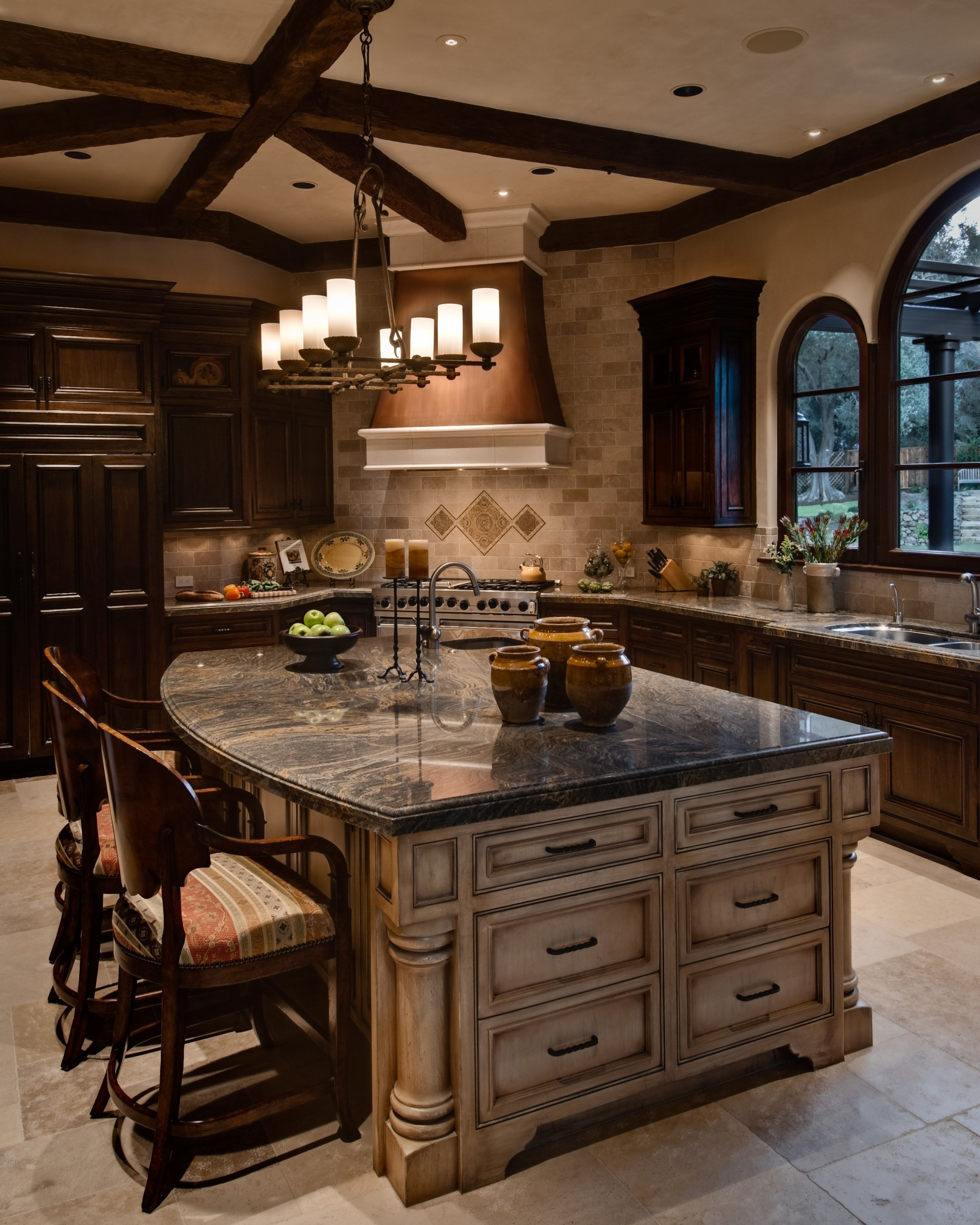 Mediterranean Kitchen features copper hood and large island with