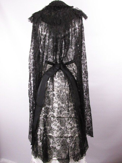 Victorian 1880s Bustle Chantilly Lace Cape Coat. Chantilly lace with silk bow accents and beaded yoke. Back
