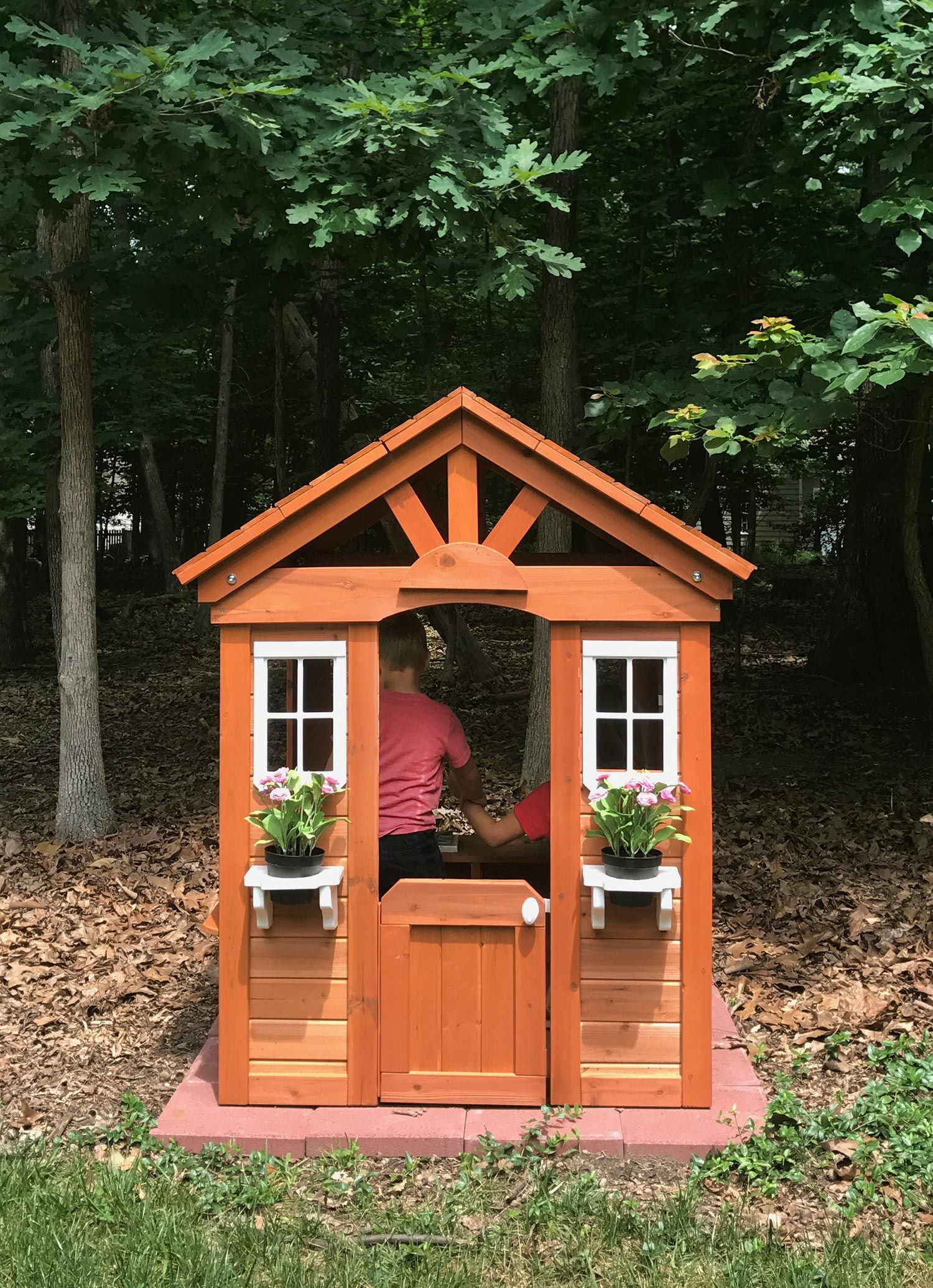 a little wooden playhouse in the woods wooden playhouse