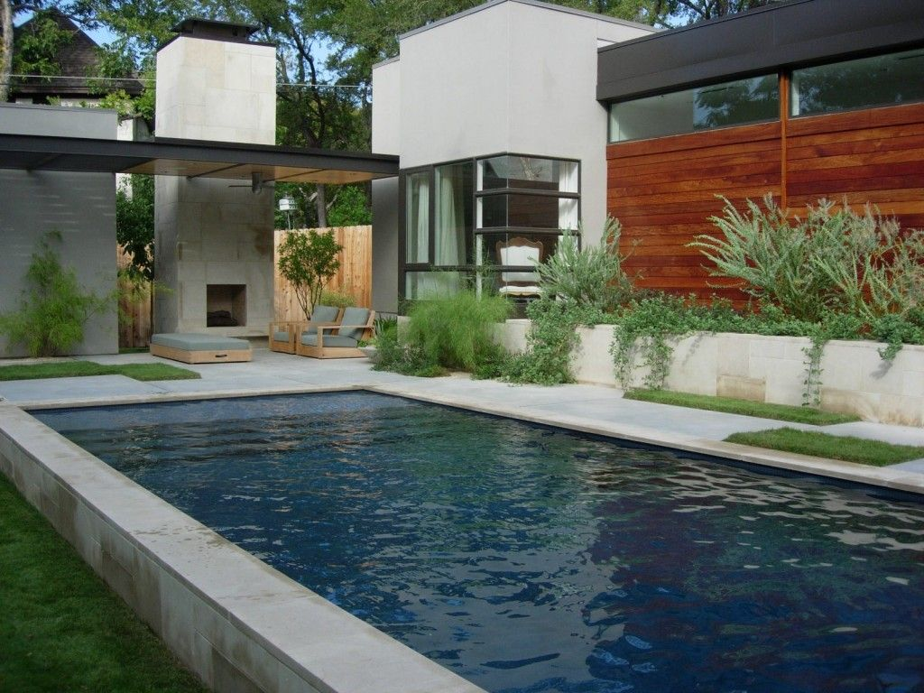 Note wide shallow ledge in pool grass patches in stone for Raised pool designs