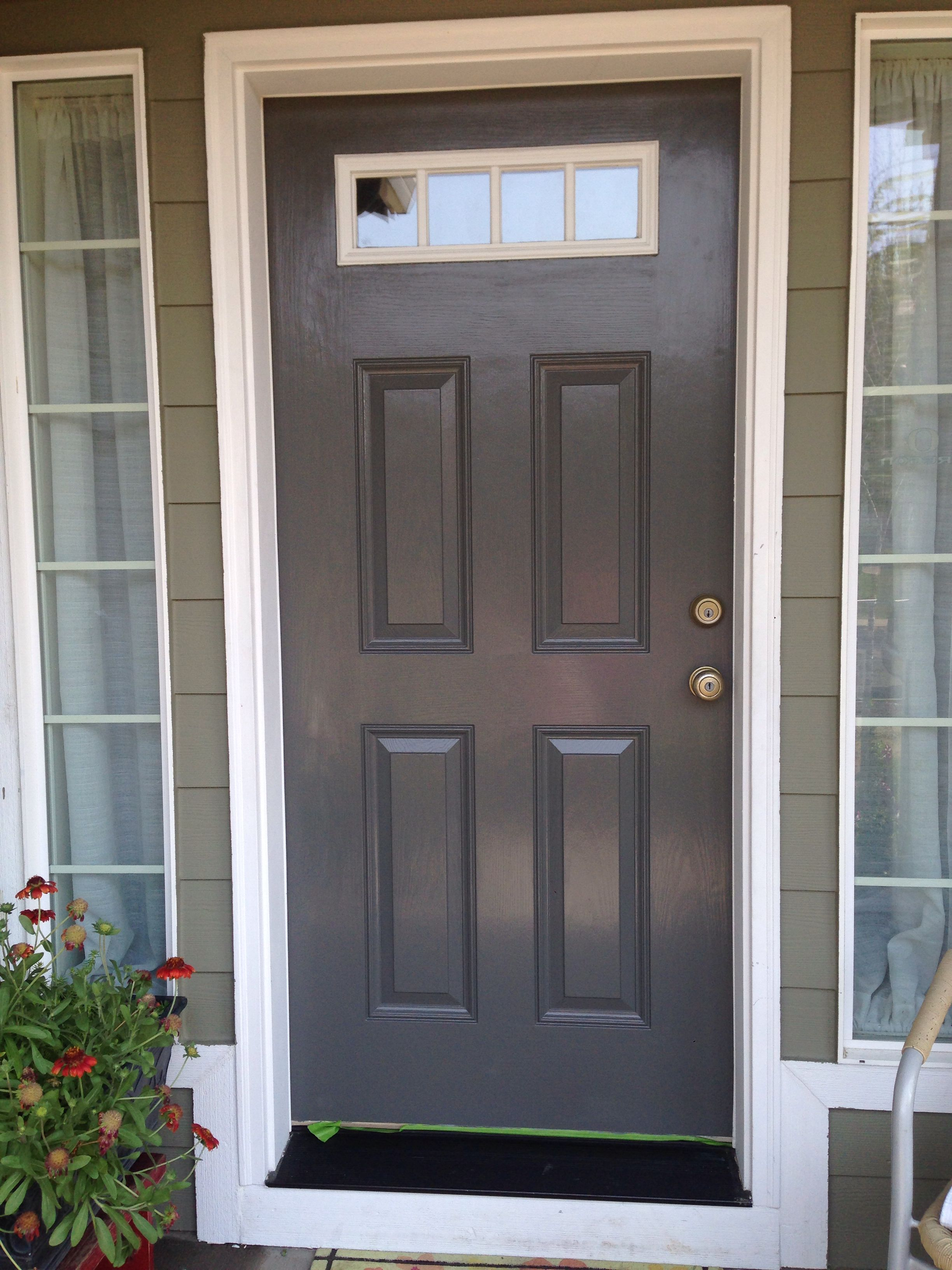 Painted Our Front Door With Behr Mined Coal Door And Trim Paint Front Door Paint Colors Painted Front Doors