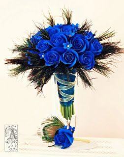 AIMEE!!  THIS!!  THIS!!!!  More peacock feathers, toss in some white blooms with purple, but I LOVE this bouquet and this bout!!  LOVE!!!  http://keepsakeblossoms.blogspot.com/2011/05/blue-rose-bouquet-with-peacock-feathers.html
