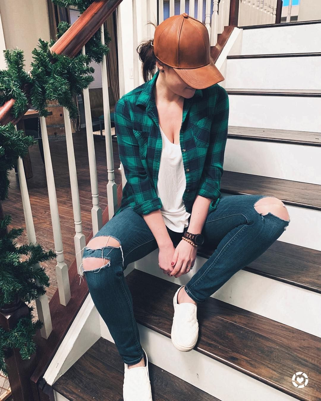 Green flannel shirt faux leather baseball hat and jeans
