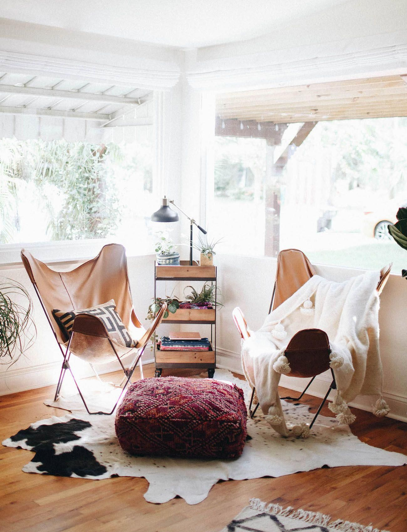 Boho seating and big windows with leather butterfly chairs