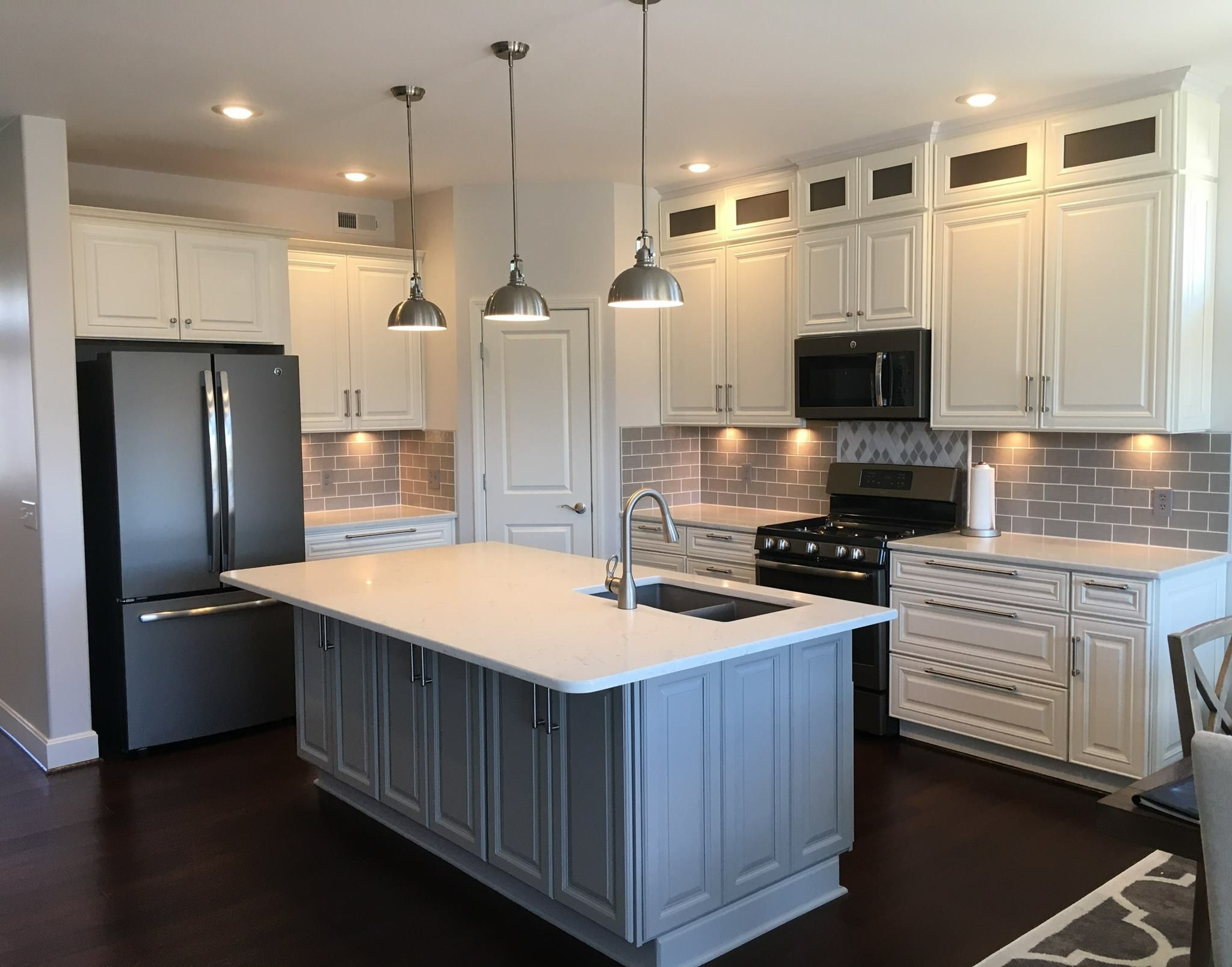 stacked upper cabinets and gray island semi custom kitchen cabinets home home renovation on kitchen cabinets upper id=97607