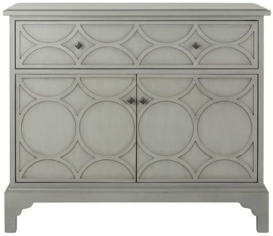 The Oly hospitality chest finished in light grey is the ideal wine bar and storage cabinet, perfect for your entertaining needs. Behind the two detailed wood doors you will find built-in wooden wine glass holder runners, slotted sections for wine bottle storage, along with a matching removable wood tray. The cabinet also has one drawer detailed with matching geometric wood work.