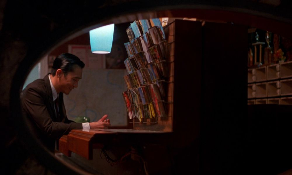 Frame within the frame to trap the character.   wong kar wai ...
