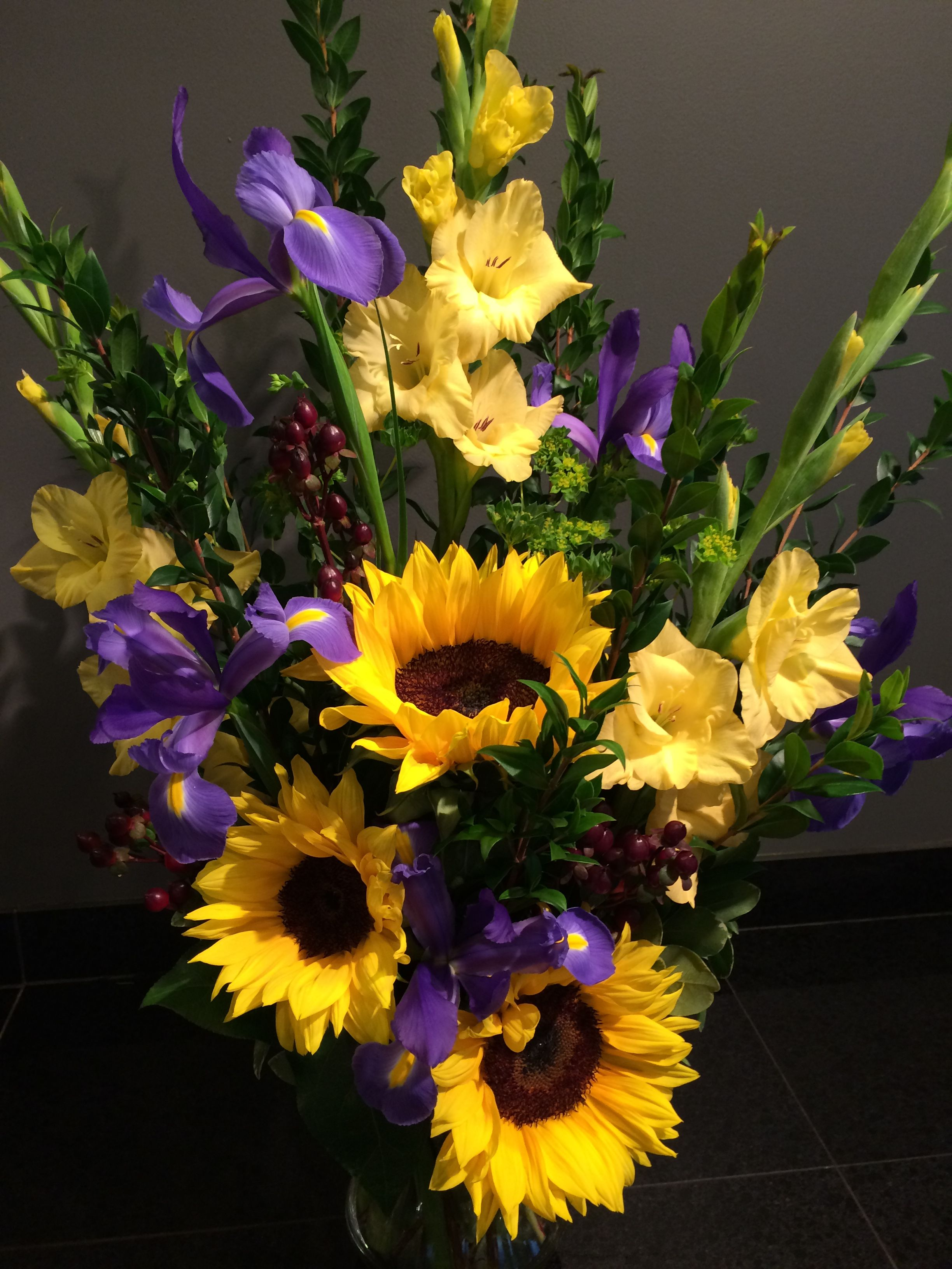Vase Arrangement With Sunflowers, Glads, Iris All The Flowers Together