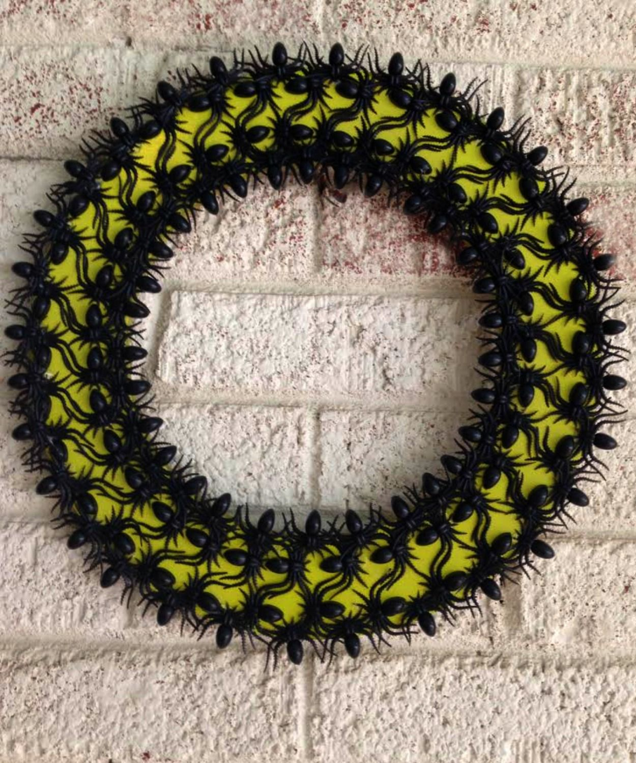 This sophisticated spooky Spider Wreath will look great hanging on a wall or outside welcoming guests. Make this simple spider wreath with a few simple supplies!