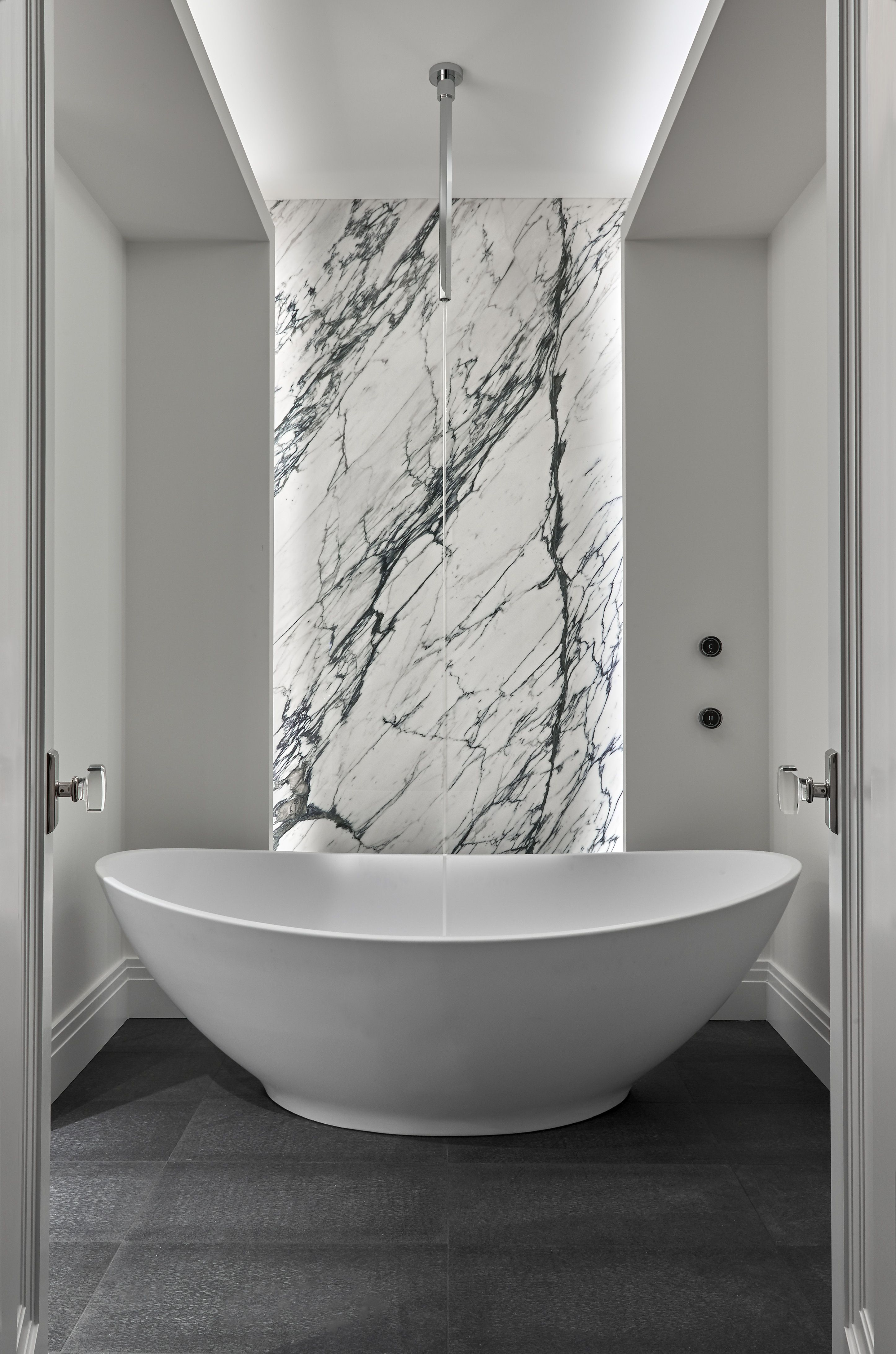 A Dramatic Ceiling Mounted Tub Filler By Fantini In A Private Gold
