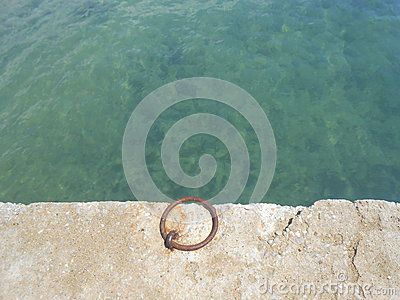 Teal Waters And An Iron Ring In A Dock - Download From Over 25 Million High Quality Stock Photos, Images, Vectors. Sign up for FREE today. Image: 43854891