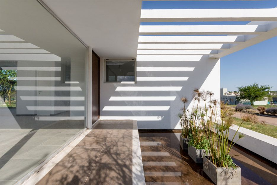 Glass walls and terraces frame views from house in Argentina