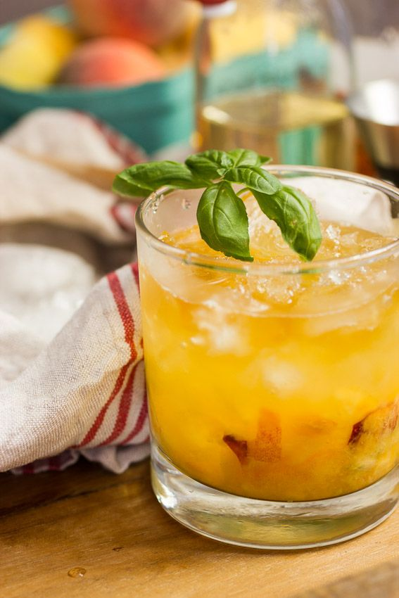 Bourbon Peach Basil Smash | A summer take on the Bourbon Smash with fresh peaches and basil.