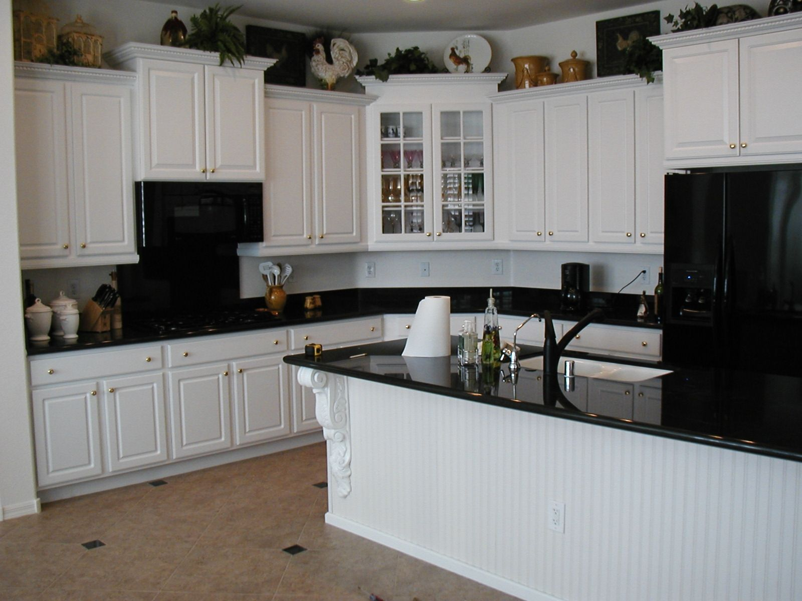 creamy white kitchen cabinets with black appliances
